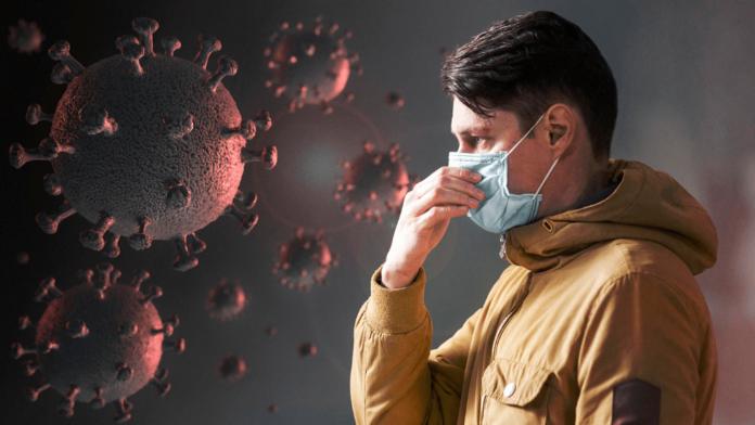 Uomo con mascherina antivirus